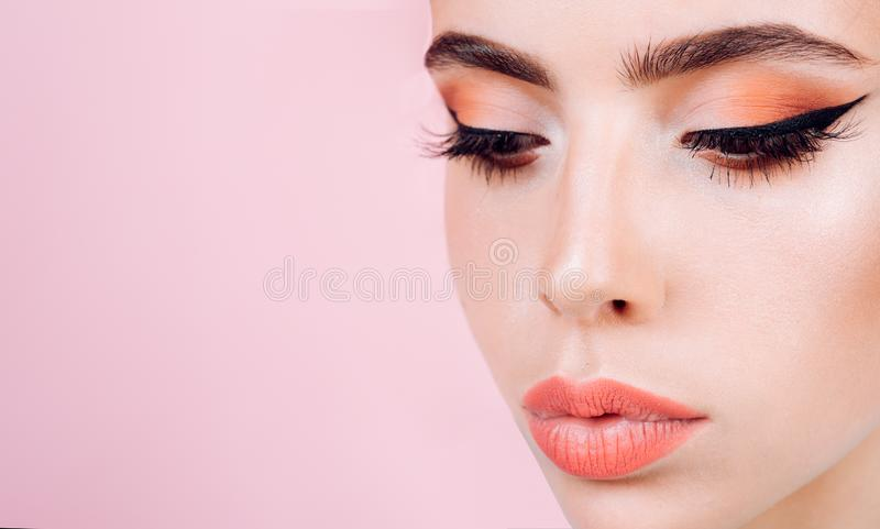 Beauty salon. retro woman with fashion makeup. Pin up girl. vintage woman with glamour arrow makeup. decorative facial. Cosmetics for pretty girl, copy space royalty free stock photography