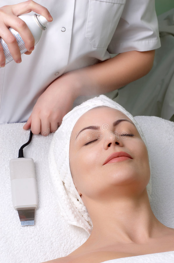 Beauty salon series, hydration before cleaning. Woman getting extra hydration procedure before skin cleaning at beauty salon stock photo