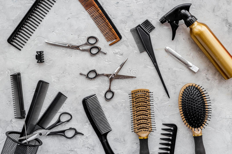 Beauty saloon. Haidressing tools on grey table background top view.  royalty free stock photo