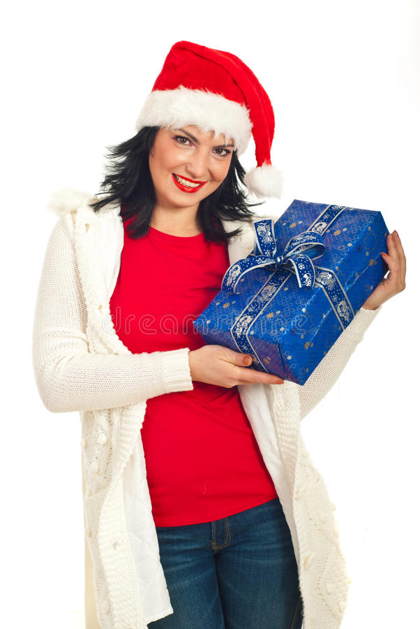 Beauty santa helper showing Christmas gfts. Beauty Santa helper with hat showing blue wrapped Christmas gift isolated on white background stock image