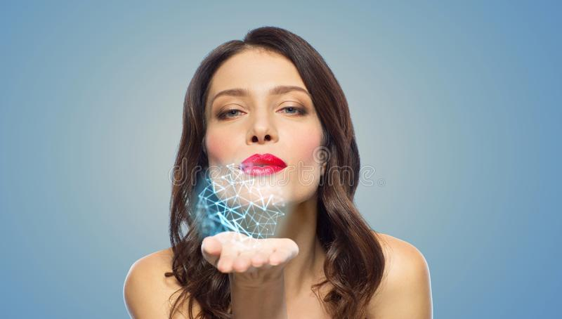 Beautiful woman blowing to low poly projection royalty free stock photos