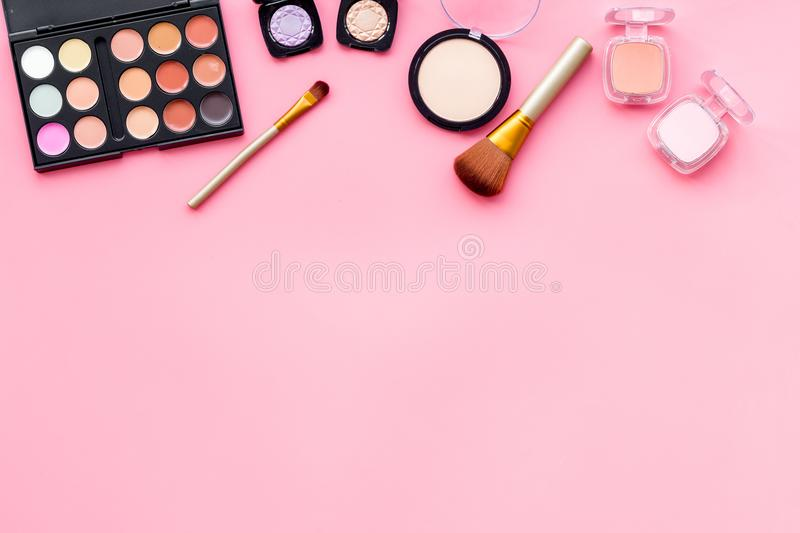 Beauty set with decorative cosmetics. eyeshadow palette, brushes on pink background top view mockup royalty free stock photo