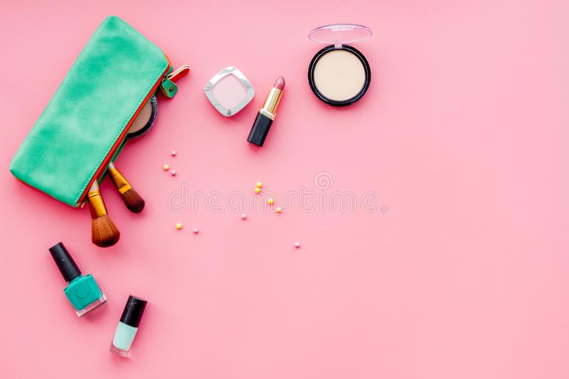 Beauty set with decorative cosmetics. nail polish, brushes and bag on pink background top view mockup stock photography