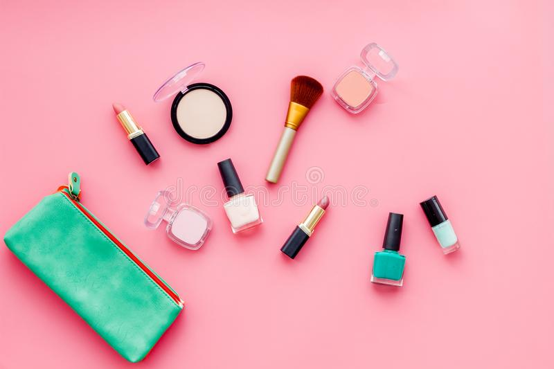 Beauty set with decorative cosmetics. nail polish, brushes and bag on pink background top view mockup royalty free stock photos