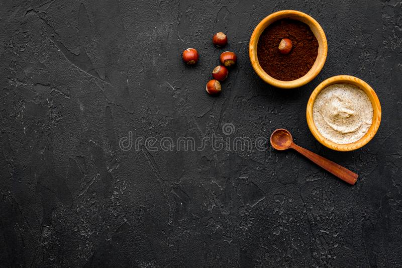 Beauty set with natural hazelnut scrub for spa on black background top view mockup royalty free stock image