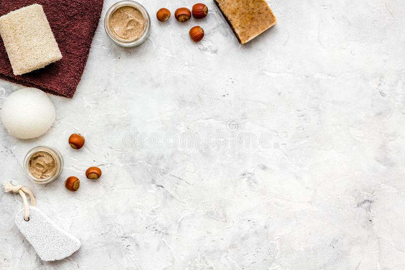 Beauty set with natural hazelnut scrub for spa on stone background top view mockup royalty free stock photo