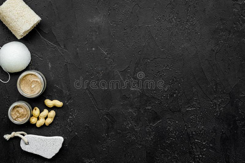 Beauty set with natural peanut scrub for spa on black background top view mockup stock images