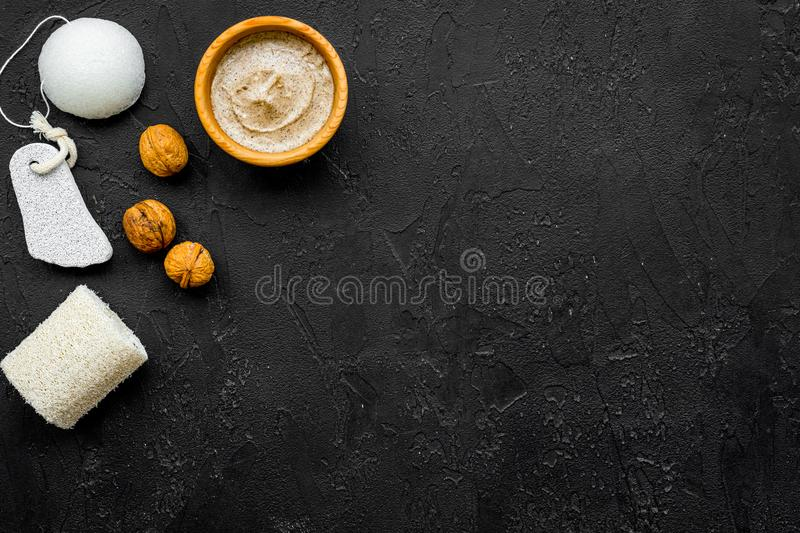 Beauty set with natural walnut scrub for spa on black background top view mockup stock photo