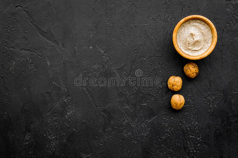 Beauty set with natural walnut scrub for spa on black background top view mockup stock images
