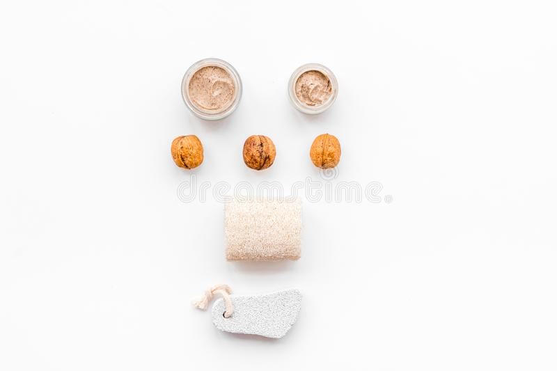 Beauty set with natural walnut scrub for spa on white background top view mockup stock photography