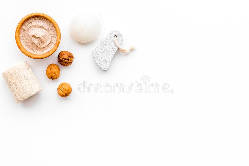 Beauty set with natural walnut scrub for spa on white background top view mockup stock image