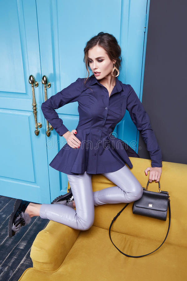 Beauty dress clothing makeup fashion style woman. Lady, fashion woman style girl pretty face wear dress leather pants silk blouse buttons hold bag high heels in royalty free stock image