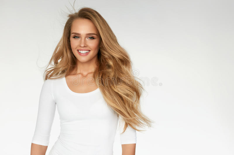 Beauty. Woman Model With Beautiful Long Blonde Hair. Beauty. Beautiful Woman With Perfect Long Blonde Wavy, Curly Hair Standing On White Background. Portrait Of royalty free stock images
