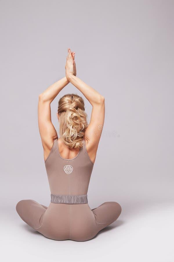 Beauty woman sport yoga pilates fitness body shape clothes stock photography
