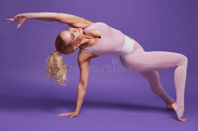 Beauty woman sport yoga pilates fitness body shape clothes stock images