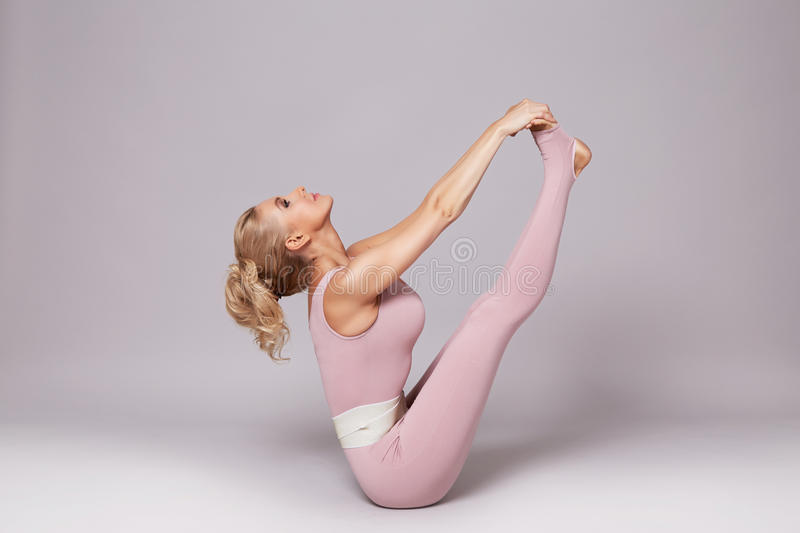 Beauty woman sport yoga pilates fitness body shape clothes. Beautiful blonde woman perfect athletic slim figure engaged in yoga, exercise or fitness, lead stock image