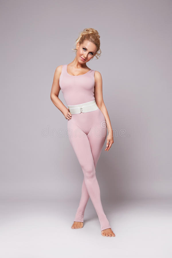 Beauty woman sport yoga pilates fitness body shape clothes. Beautiful blonde woman perfect athletic slim figure engaged in yoga, exercise or fitness, lead stock photography