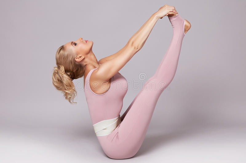 Beauty woman sport yoga pilates fitness body shape clothes. Beautiful blonde woman perfect athletic slim figure engaged in yoga, exercise or fitness, lead stock images