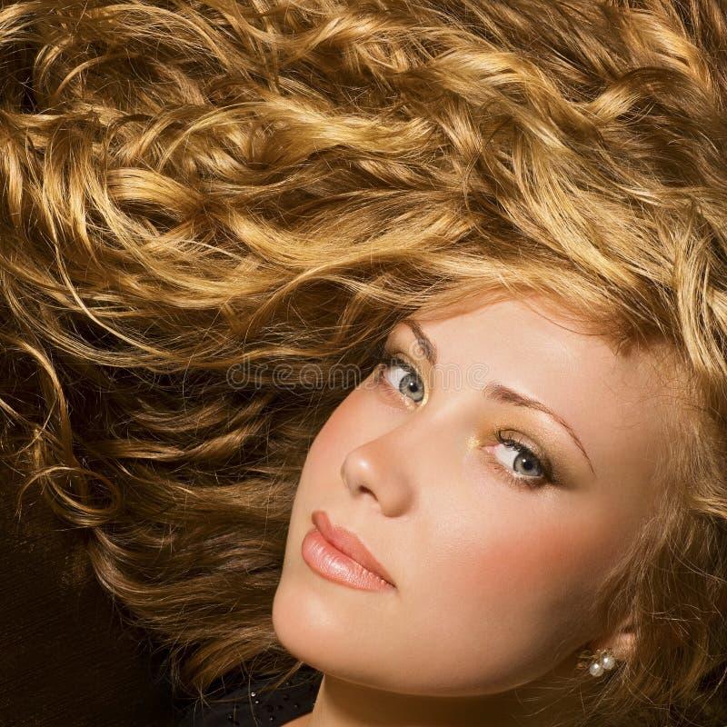 Beauty with shiny golden hair royalty free stock photo