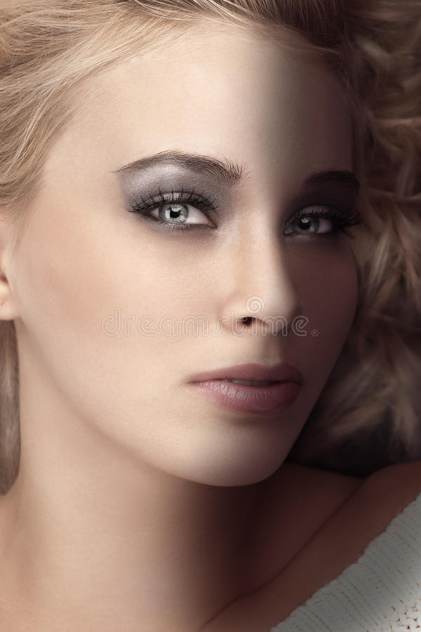 Beauty shot of a blonde with very expressive eyes royalty free stock photos