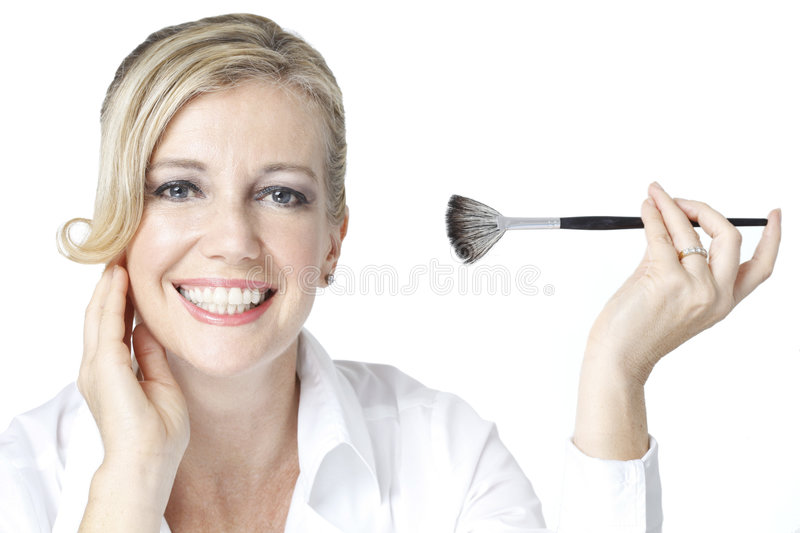 Beauty shot of Caucasian woman with make-up brush royalty free stock photos