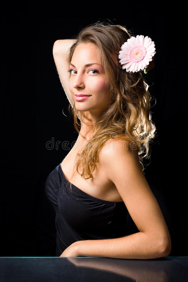 Beauty shot of gorgeous brunette with flower. stock photos
