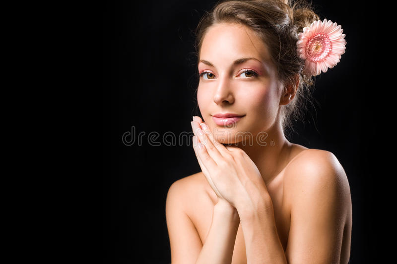 Beauty shot of gorgeous brunette with flower. royalty free stock photos