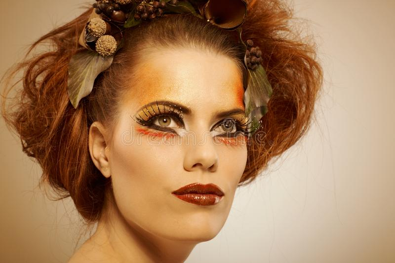 Beauty shot woman in autumn makeup stock photography