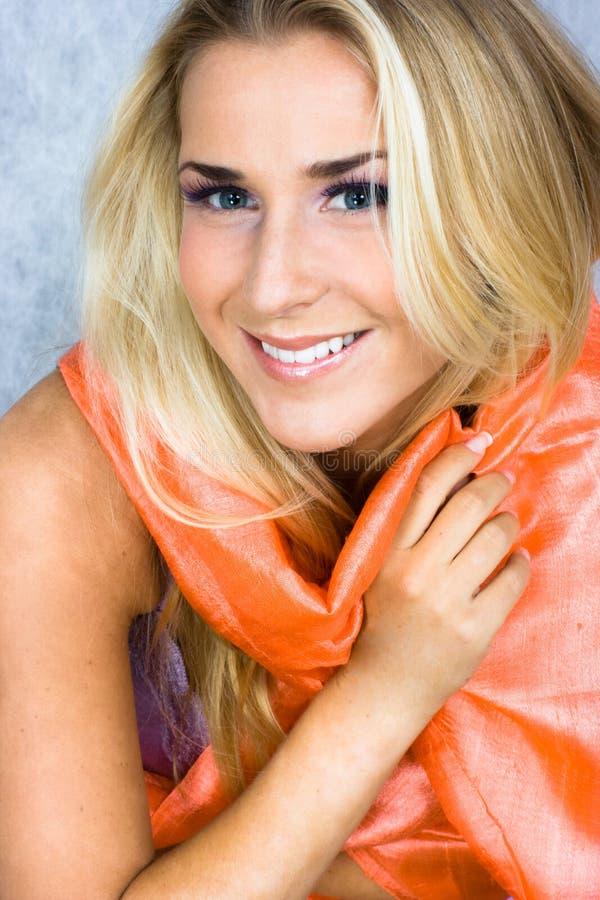 Beauty in silk scarf. Blond beauty in silk scarf in studio shot stock photography