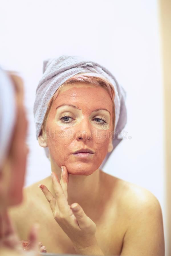 Beauty Skin Care Concept - woman with a face mask stock photography