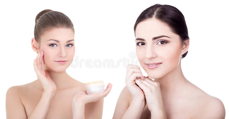 Beauty and skin care concept -young beautiful smiling women with. Cream bottle on white background royalty free stock images