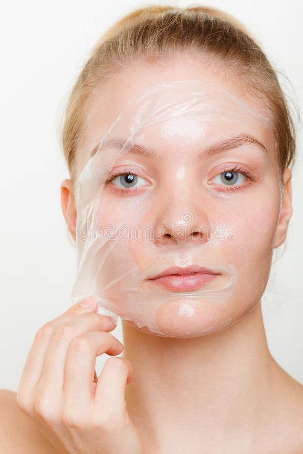 Woman removing facial peel off mask. Beauty skin care cosmetics and health concept. Young woman face, girl removing facial peel off mask. Peeling stock photos