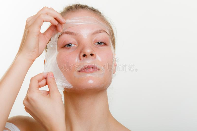 Woman removing facial peel off mask royalty free stock photo