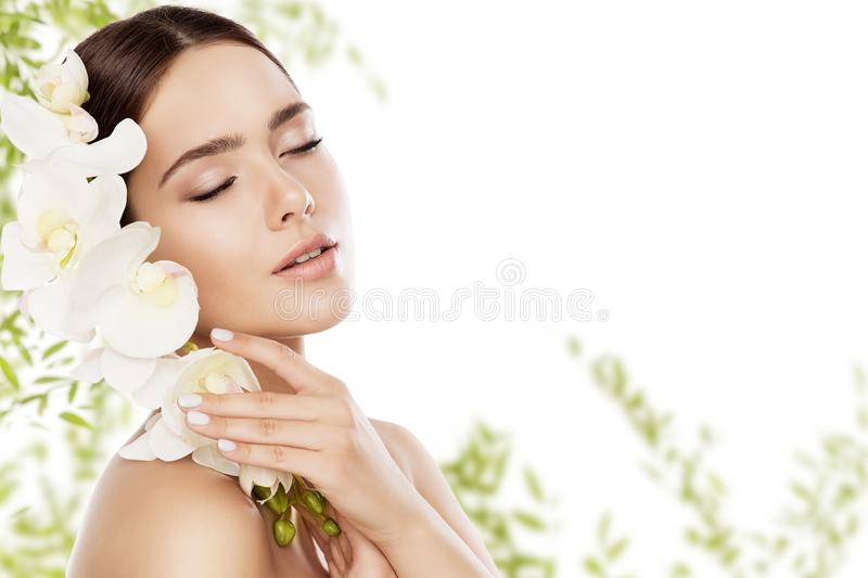 Beauty Skin Care and Face Makeup, Woman Skincare Natural Make Up. Beautiful Model and Orchid Flower, eyes closed