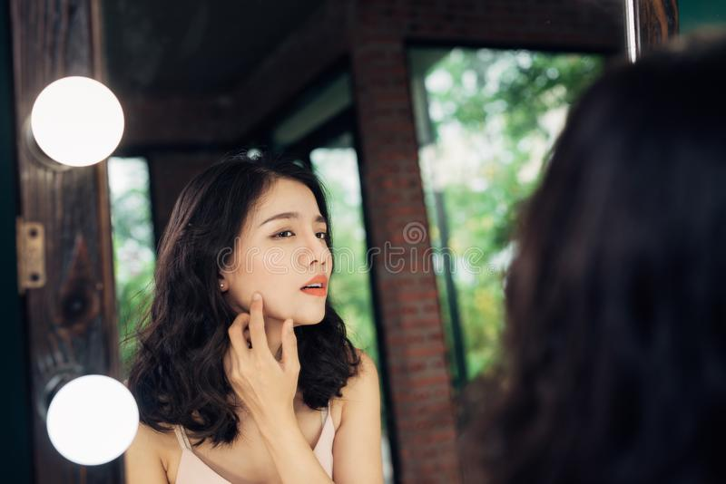 Beauty, skin care lifestyle concept. Young asian woman with acne stock photography
