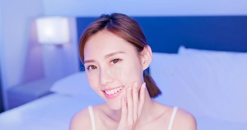 Beauty woman touch her face stock images