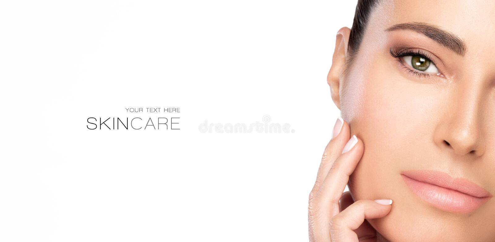 Beauty and Skincare Concept. Beautiful natural young woman face with nude makeup on a flawless skin stock image