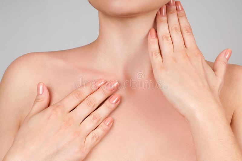 Beauty and Skincare concept. Beautiful woman touching her neck stock image