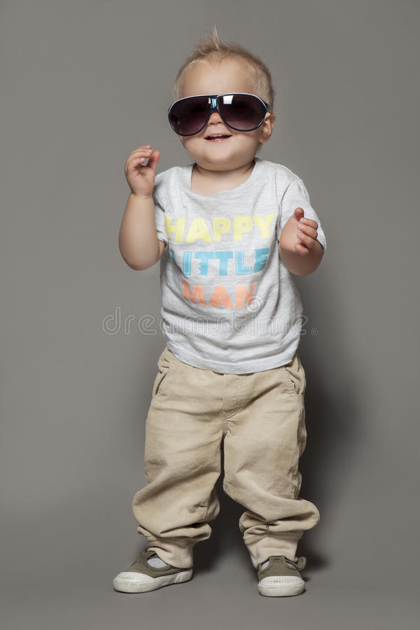 Beauty smiling child boy in sunglasses royalty free stock photography