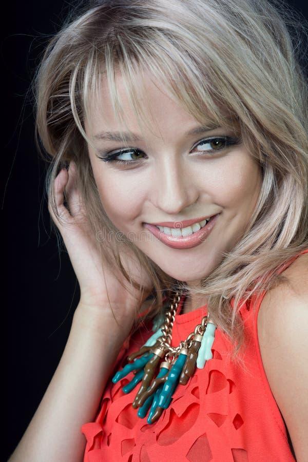 Beauty smiling fashion model woman portrait, isolated on black background stock image