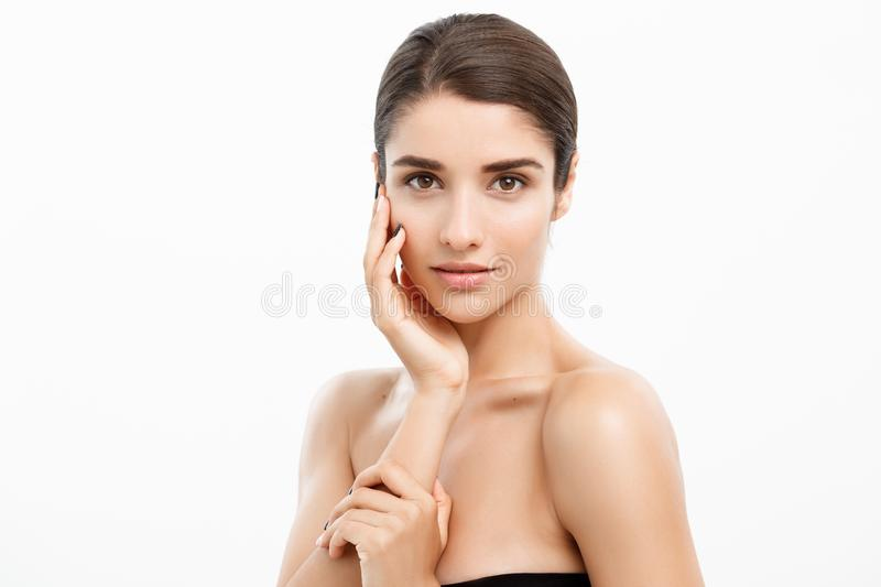 Beauty and spa concept - Charming young woman with perfect clear skin over white background. royalty free stock photography