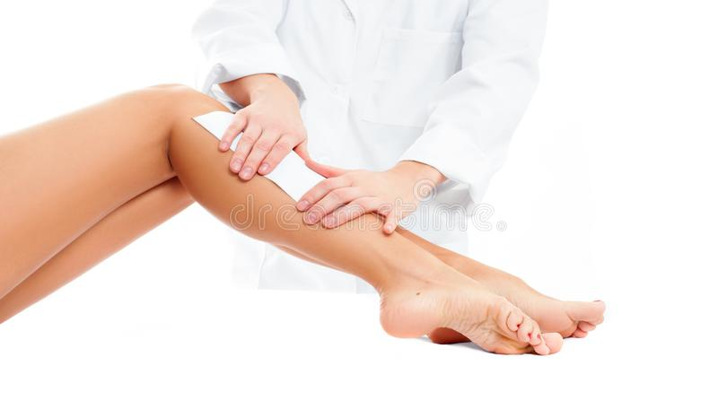 Beauty Spa. Hair removal cosmetology procedure. Beautician waxing female legs. Beauty Spa. Hair removal cosmetology procedure. Beautician waxing a female leg royalty free stock photo