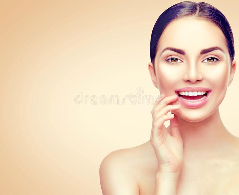 Beauty spa woman touching her face and smiling. Teeth whitening royalty free stock images
