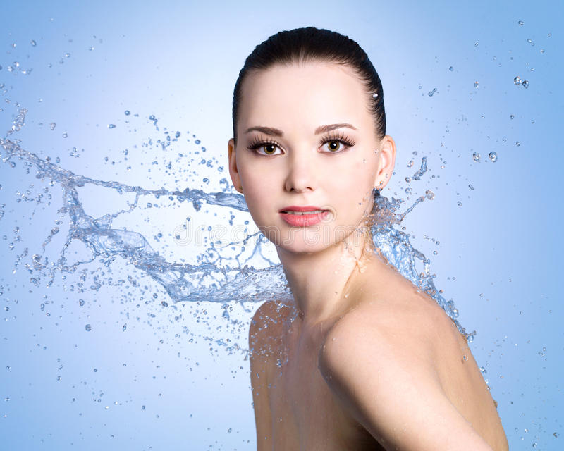 Beauty splashes of water for woman royalty free stock image