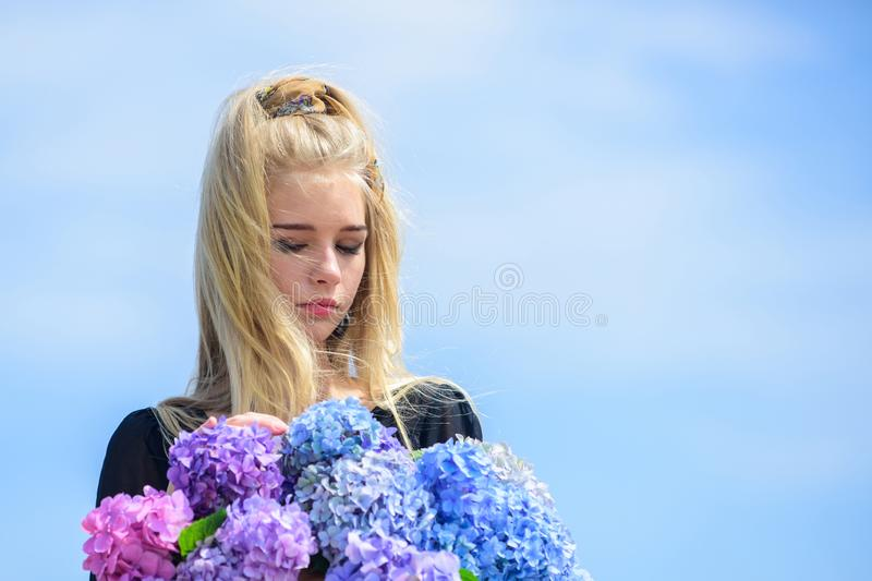 Beauty of spring season. Girl tender blonde hold hydrangea bouquet. Skin care and beauty treatment. Springtime bloom. Gentle flowers for delicate woman royalty free stock photos