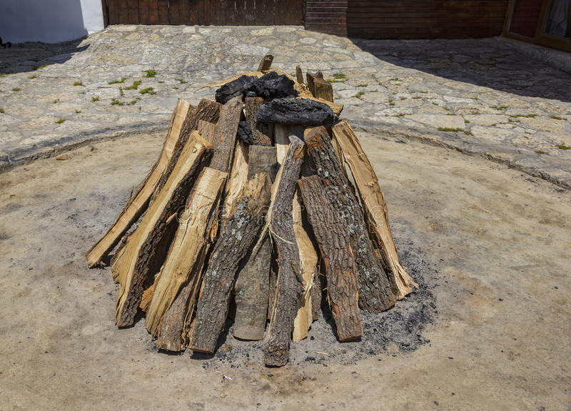 Beauty stacked. Dry wood and coal for the hearth royalty free stock image