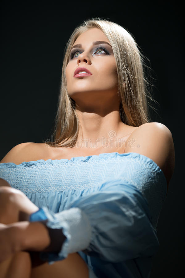 Beauty. Studio photo of visage model looking up stock photo