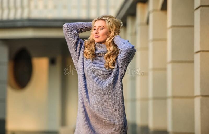 Beauty in style. cashmere woolen sweater. warm oversized clothes. sexy woman sunny weather outdoor. free style royalty free stock photo