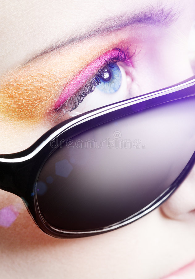 Beauty styled Glasees. Blue eye and strong makeup - beauty styled royalty free stock images