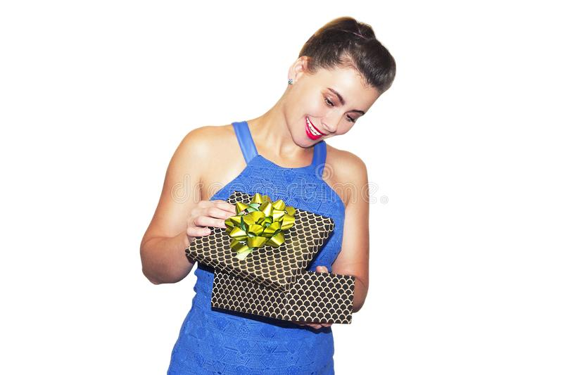 Beauty stylish girl opens gifts isolated on white background. brunette woman with gift box. Fashion model on Christmas. Beauty stylish girl opens gifts isolated stock photography